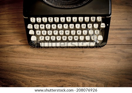 A Vintage Typewriter on a wooden table. - stock photo