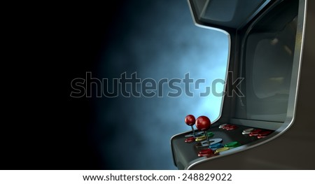 A vintage unbranded arcade game with a joysticks and buttons and a blank screen on a dark ominous background with copy space - stock photo