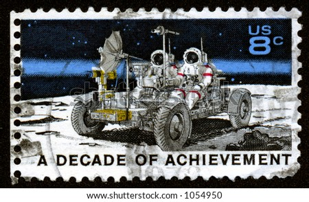 A vintage US stamp depicting the apollo mission with the moon buggy. Thirteen Cents. A decade of acheivement. - stock photo