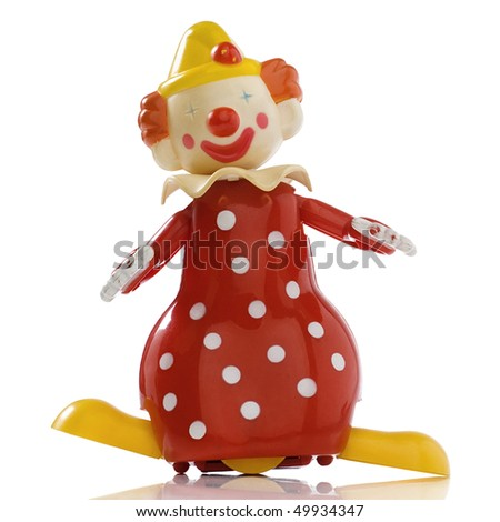 a vintage windup toy clown - stock photo