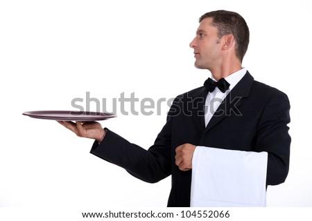 A waiter holding an empty tray - stock photo