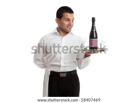 A waiter, servant or bartender looking at a wine product on a silver tray and smiling.  White background. - stock photo