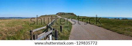 A walking path on Hengistbury Head, between the cities of Christchurch & Bournemouth in Dorset, England, with Warren Hill directly ahead. - stock photo