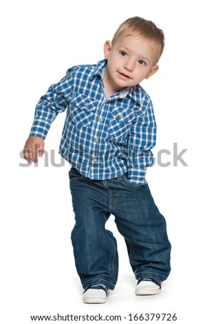 A walking preschool boy on the white background - stock photo