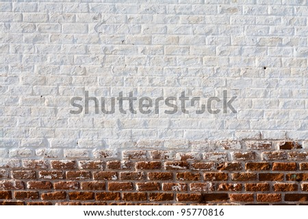 A wall made of stones in the countryside - stock photo