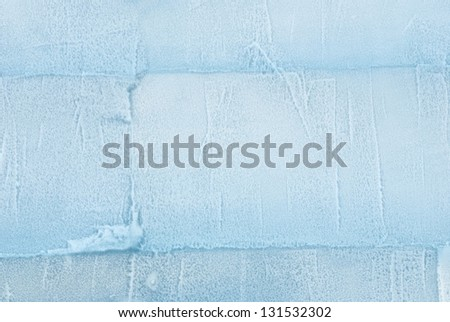 a wall made out of ice as texture or background - stock photo