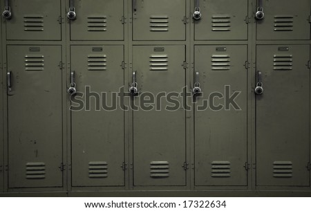 A wall of beige school lockers typical of an American public high-school - stock photo