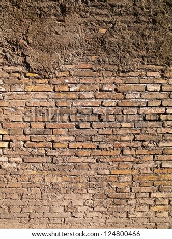 A wall of bricks of uniform size and color - stock photo