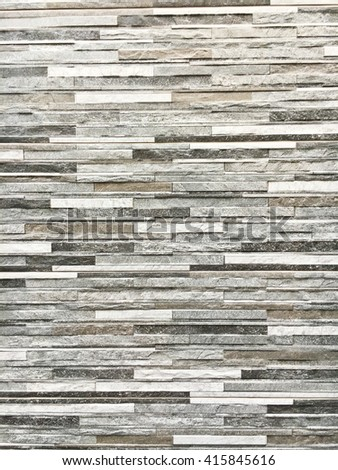 A wall of decorative stone tiles as a background - stock photo