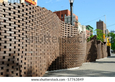 A wall sculpture in Lower Manhattan. - stock photo
