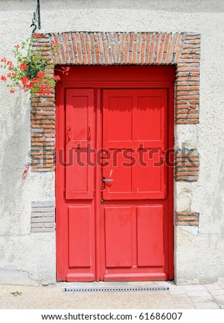 A wall with a red door - stock photo