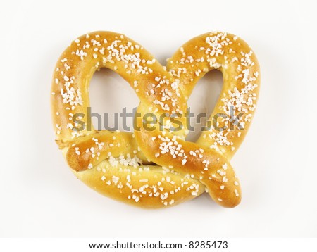 A warm and chewy salted soft pretzel. - stock photo