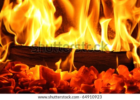 A warm fire in a chimney - stock photo