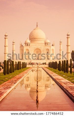 A warm shot of the Taj mahal seen with the reflecting pool. - stock photo