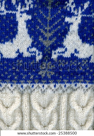 A warm sweater with two reindeer, fragments, closeup. - stock photo