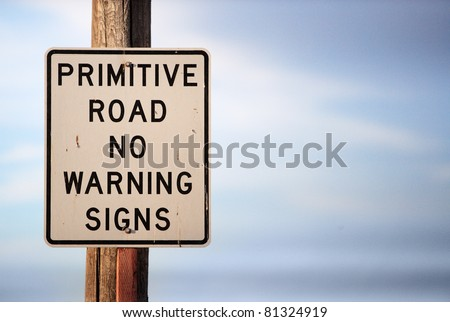 A warning sign warning that there are no warning signs.  A business metaphor for moving into uncharted waters, trying something that has never been tried before, or a leap of faith. - stock photo