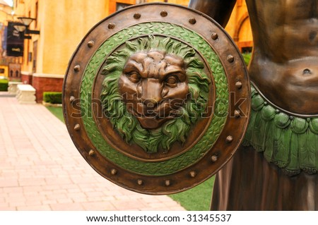 A warrior's shield with the Roman insignia - the lion' s head.