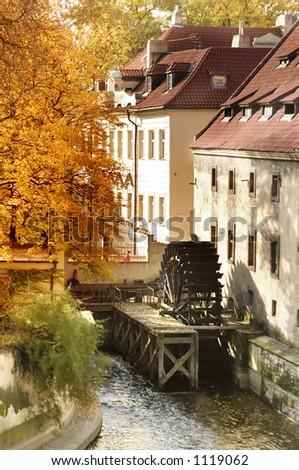 A water mill on a river in Prague, Czech Republic. - stock photo
