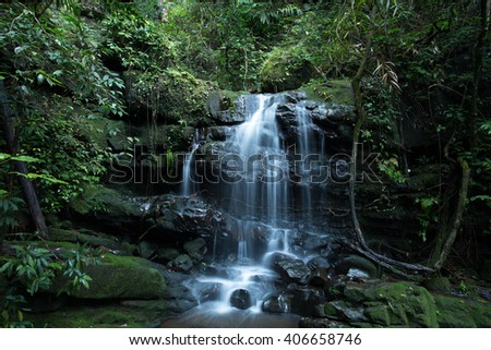 A waterfall called Saithip is located in Phu Soi Dao peak in the North of Thailand, that is over one thousand meters above sea level. To reach this waterfall, is only by trekking of 4-6 hours. - stock photo