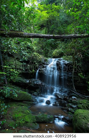 A waterfall called Saithip, is located in Phu Soi Dao peak in the North of Thailand. The waterfall is at over one thousand meters above sea level. Only by trekking to reach the Saithip waterfall. - stock photo