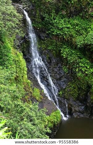 A waterfall on 'Road to Hana' on the Hawaiian Island of Maui - stock photo
