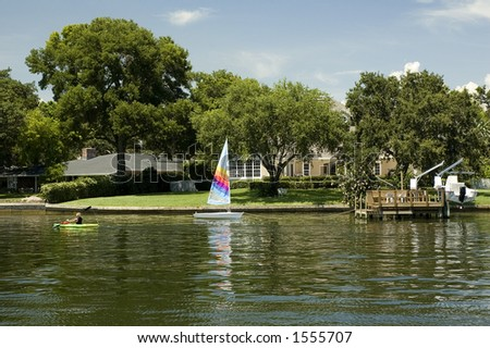 A waterfront home in St. Petersburg, Florida, with kayaker - stock photo