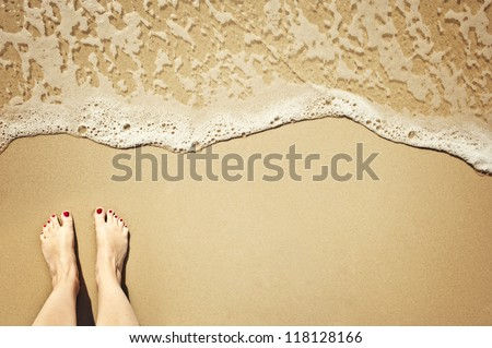 a wave comes in, as I stand and wait. copy space. top down view. - stock photo