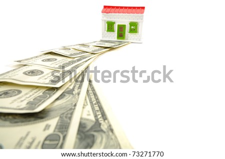 A way to get a new house, dollars and house over white background