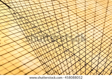 a weathered and yellowed geometrical or mathematical grid for calculations