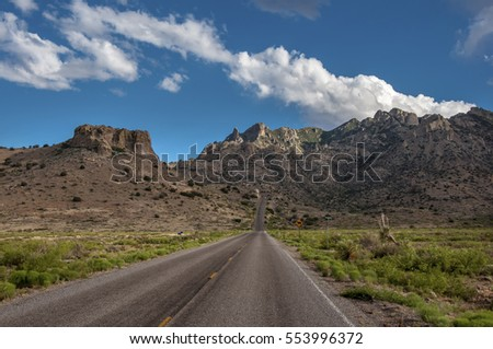 A weathered asphalt road leads up in to Lover's Leap Canyon in southern New Mexico's Florida Mountains.