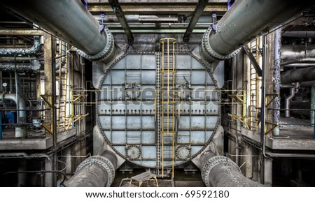 A weathered metal construction at an abandoned power plant. - stock photo