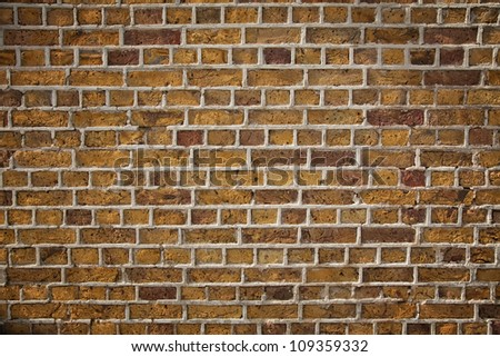 A weathered old brick wall with extensive morter. - stock photo