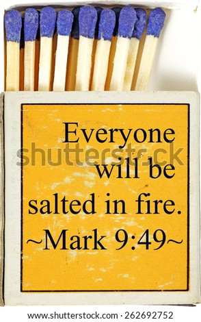 "A weathered yellow matchstick box with a spiritual bible verse from Mark 9:49 ""Everyone will be salted in fire"". - stock photo"