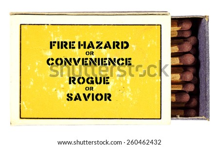 """A weathered yellow matchstick box with the fire safety message """"Fire Hazard or Convenience, Rogue or Savior"""", isolated against white. - stock photo"""