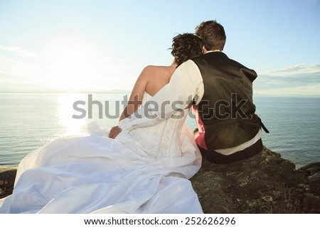 A wedding couple with sky on the background - stock photo