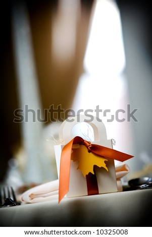 a wedding favor on a table during a social event - stock photo