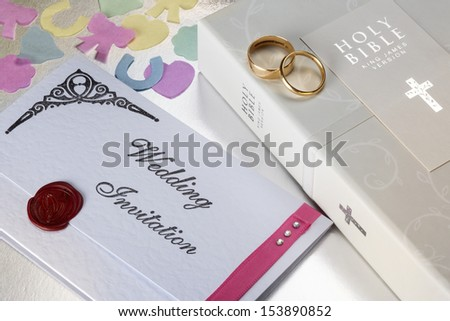 A Wedding Invitation and Holy Bible.