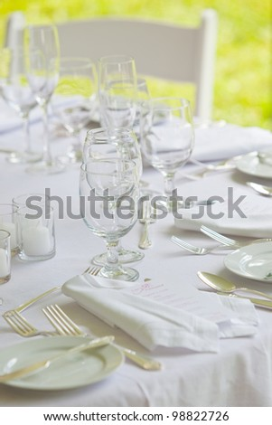 A wedding table set up for fine dining in all white