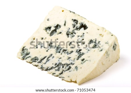 A wedge of full fat soft blue cheese isolated on white.
