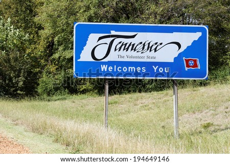 A welcome sign at the Tennessee state line. - stock photo