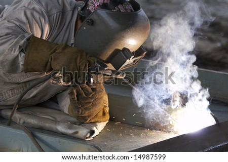 a welder working at shipyard during day shift