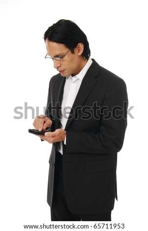 A well dressed businessman sending a text message