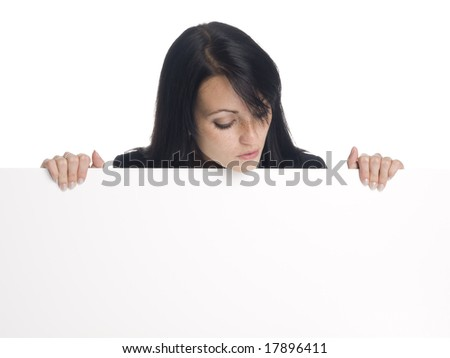 A well dressed businesswoman holds a blank sign ready for your message.