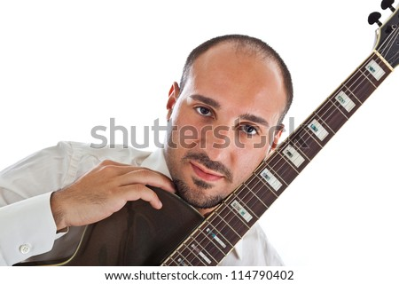 a well dressed jazz musician with a guitar - stock photo