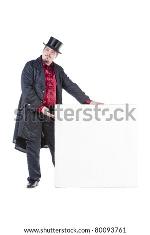 A well dresses Gentleman with top hat is showing a blank sign
