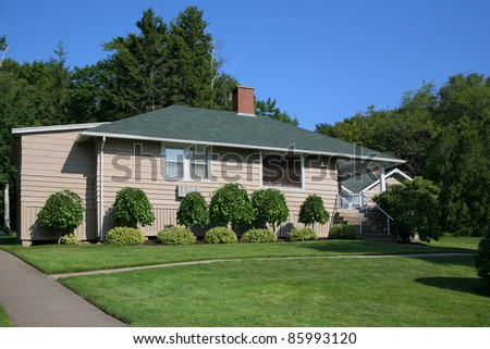 A well landscaped old fashioned bungalow. - stock photo