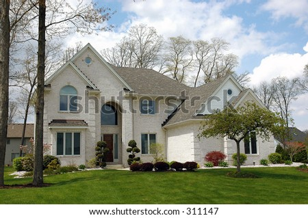 A well maintained newer house with beautiful landscaping.