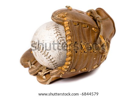 A well used baseball glove with a worn ball on a white background. - stock photo