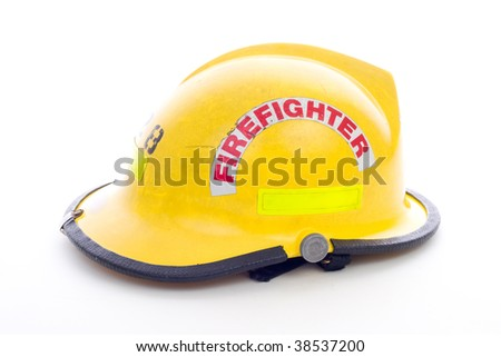 A well used Yellow Fire Fighters Helmet on White - stock photo