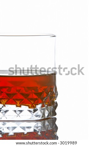 A whiskey glass reflected on white background
